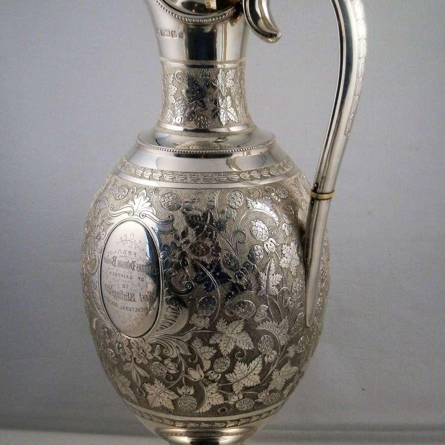 An ornate Victorian silver presentation claret jug, 1877