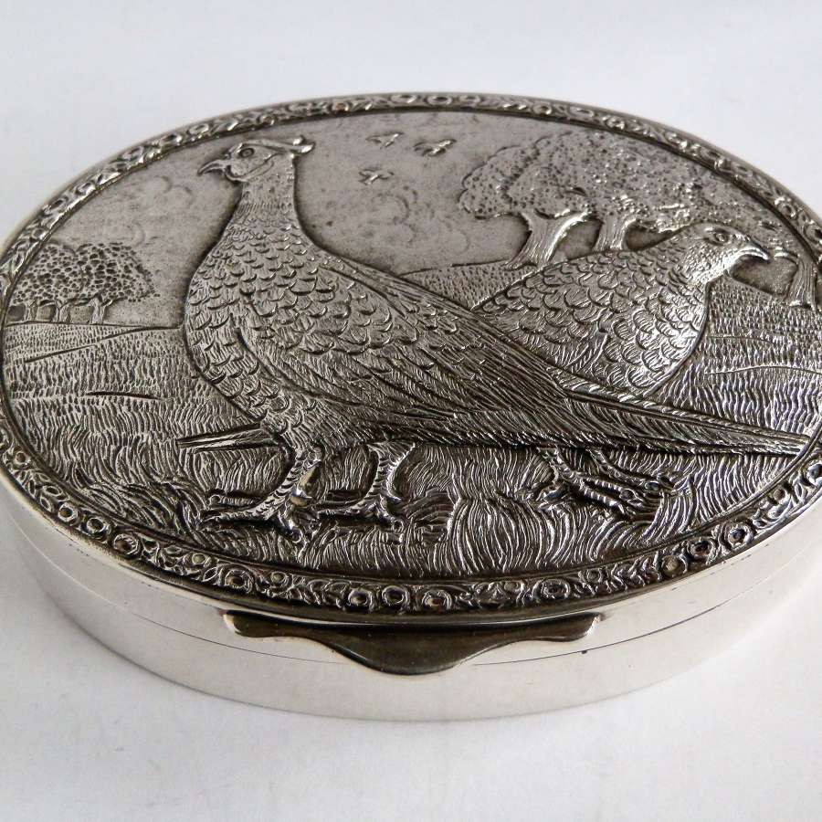 Elizabeth II silver snuff box with cast pheasants, 1983