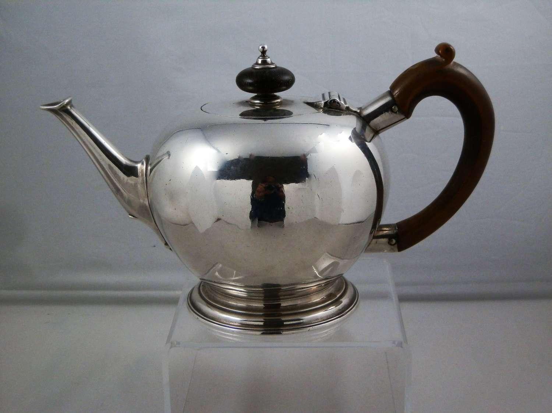 George I or II saffron silver bullet teapot, London, 1727