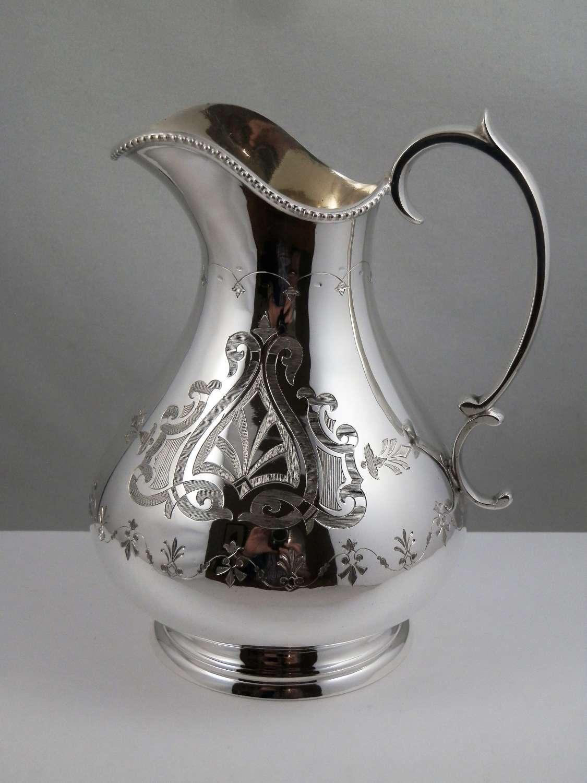 Victorian silver Gothic style cream jug, Sheffield 1869