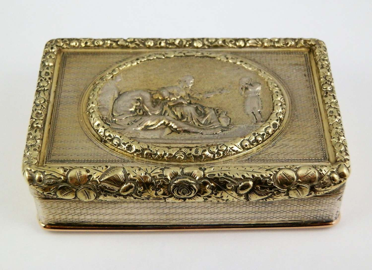 George III silver gilt cast top snuff box, London 1818