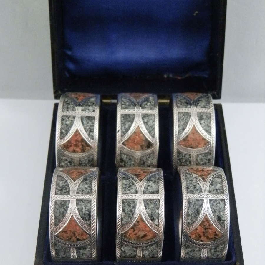 Edwardian set of 6 silver and granite napkin rings, 1904.