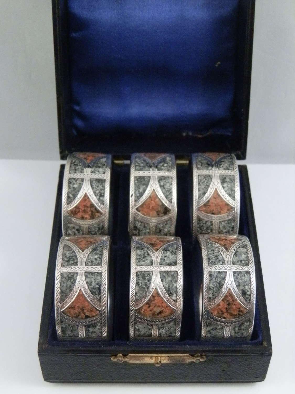 Edwardian set of 6 silver and granite napkin rings, 1904.