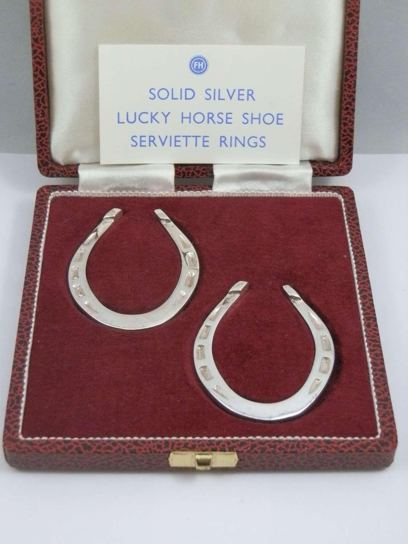 A pair of silver horseshoe napkin rings, Sheffield 1973