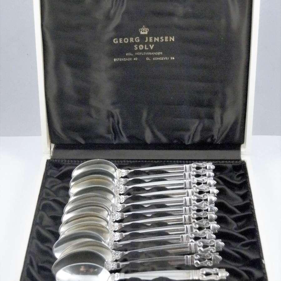 Set of 12 Acorn silver teaspoons by Georg Jensen.