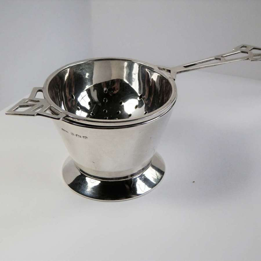 An Art Deco silver 2 piece tea strainer, Birmingham 1944