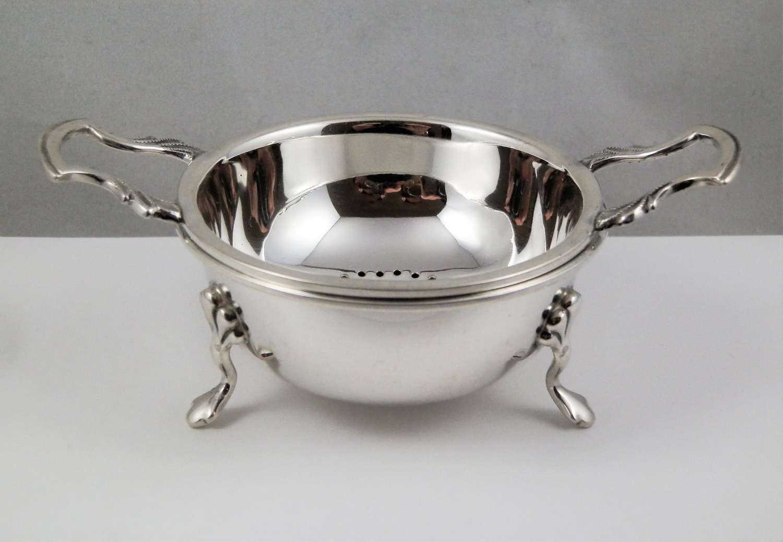 Elizabeth II silver two piece tea strainer, Birmingham 1962
